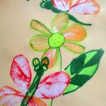 Изображение цветка и бабочки